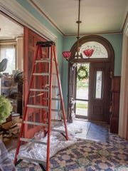 Renovations in the front entrance of the octagon house owned by George and Debra Whelan in Marshall.