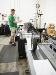 Machine operator Mike Austin of Penfield runs the inkjet printing machine at Mail Technologies Inc in Ogden.
