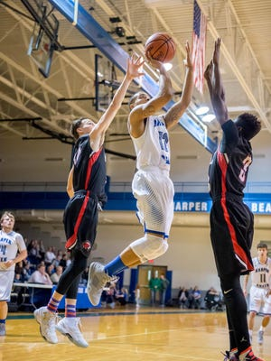 Harper Creek's Brandan Settles (12) goes for the basket against Marshall Friday evening.