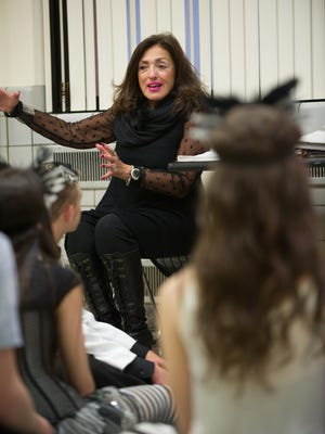 """2015 Tony Awards First Annual Excellence in Theater Education Award Nominee Judith Ranaletta of Brigton, rehearses """"Masquerade"""" with the ROC City Singers, a group of several area high school students."""