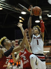 New Albany's Romeo Langford (right) shoots against