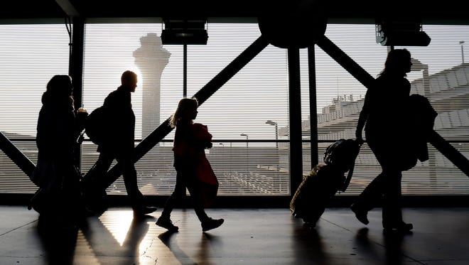 Travelers walk through Terminal 3 at Chicago's O'Hare International Airport.
