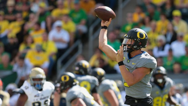 Sep 3, 2016; Eugene, OR, USA;  Oregon Ducks quarterback Dakota Prukop (9) throws the ball in the first quarter against the UC Davis Aggies at Autzen Stadium. Mandatory Credit: Scott Olmos-USA TODAY Sports