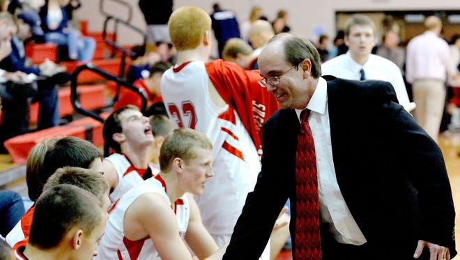 Susquehannock head coach John Zerfing celebrates with his players following a win over Spring Grove in December of 2009.