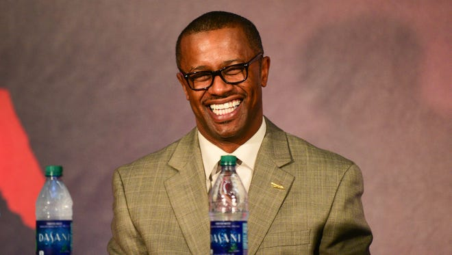Florida State's new head coach Willie Taggart shares a laugh with the audience at Doak Campbell Stadium.