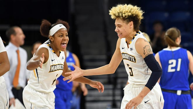 Natisha Hiedeman (right) and Danielle King are two seniors for the Marquette women's basketball team this season.