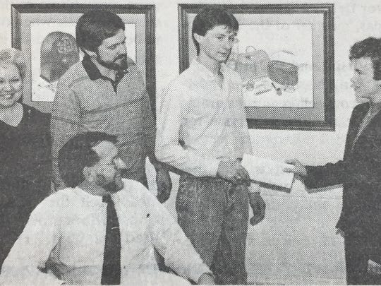 From left are Women's Club vice-president Jane Pfingston, Richard Vincent, DECA advisor Mike Hamilton, DECA President Eric Teague and Women's Club president Nancy Brinkley presenting a $50 check in March 1988.