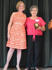 Emma Hall's good friend Marilyn Woodard, right, accepted a gift on her behalf. Woodard is pictured with Meagan Frazier Grosvenor.