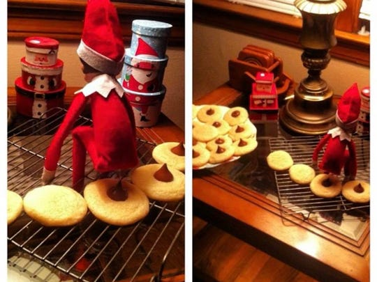 "Elf on the Shelf ""pooping"" over Hersey's Kiss blossom"