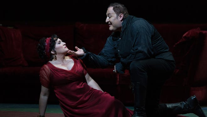 "Soprano Patricia Racette, as Tosca, and baritone George Gagnidze star in the Metropolitan Opera's 2013 production of Puccini's ""Tosca."" Regal Santaim will show the Met's ""Live in HD"" recording of the operat at 7 p.m. Wednesday, June 22."