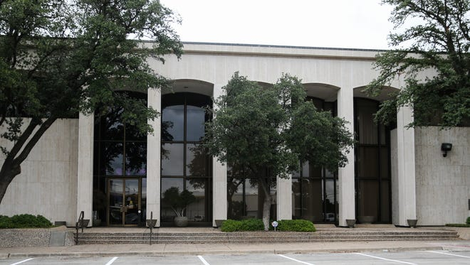 The new City Hall Annex, formerly the First Financial Bank building, at  301 W. Beauregard Ave.