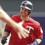 Dozier hits 3 HRs for Twins, but Royals romp 11-5