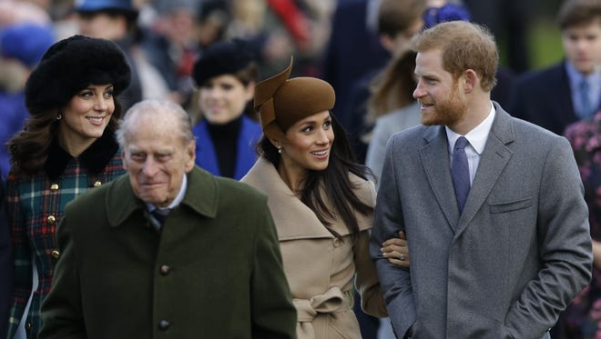 Kate, Duchess of Cambridge, left, Prince Philip, 2nd left, with Meghan Markle, 2nd right, the fiancee of Prince Harry, right walk to the traditional Christmas Day church service, at St. Mary Magdalene Church in Sandringham.