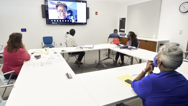 Medical professionals on a video call from Africa talk about the challenges of treating patients with cancer at the Georgia Cancer Center in Augusta, Ga., Tuesday morning July 21, 2020.