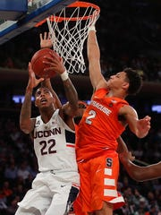 Connecticut guard Terry Larrier shoots against Syracuse