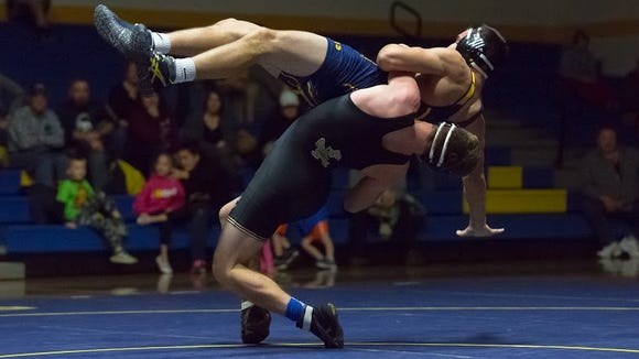 Delone Catholic's Zach Hart takes down Littlestown's Connor Geiman during a match at Littlestown High School on Wednesday. Delone won the match, 48-31.