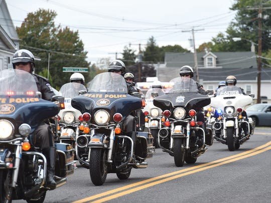 The motorcade leaves Saint Joseph Church in Glasco during Thursday's funeral for Ulster County Sheriff Sergeant Kerry Winters.