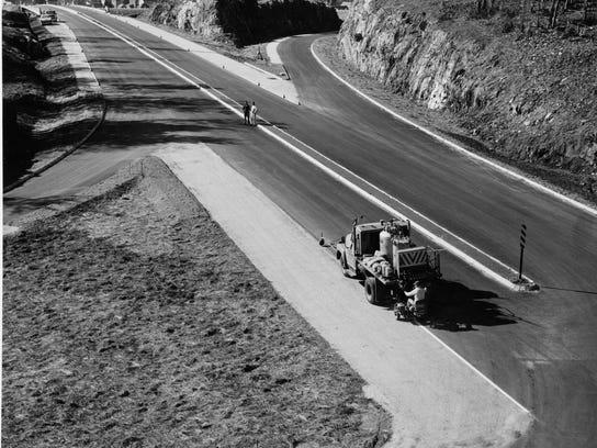 Marking lines  near Waterbury on Oct. 17, 1960.