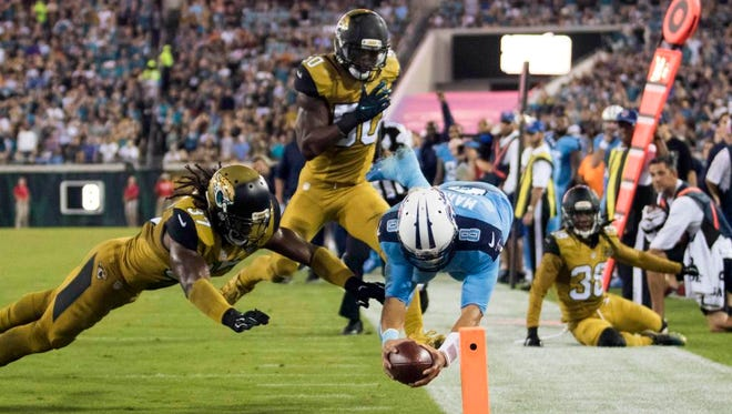 Titans quarterback Marcus Mariota completes a 23-yard touchdown run against the Jaguars.