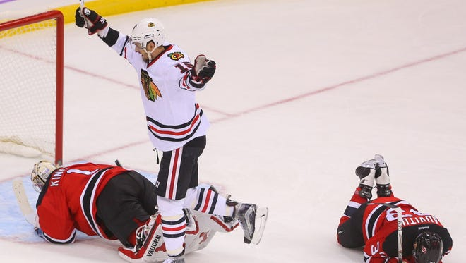 Blackhawks center Artem Anisimov (15) celebrates after scoring the game-winning goal in overtime against the Devils.