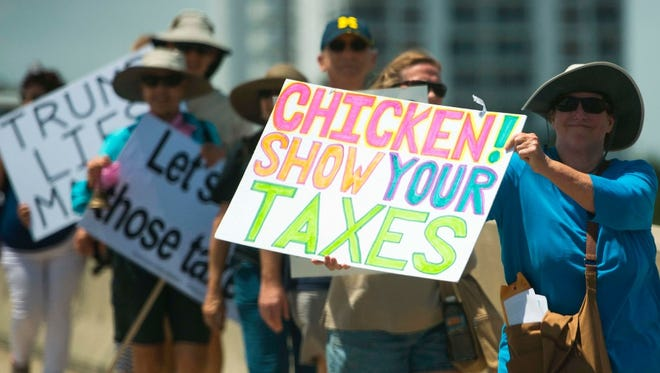 Protesters outside Mar-a-Lago call on President Trump to release his tax records, Palm Beach, Fla.,  April 15, 2017.