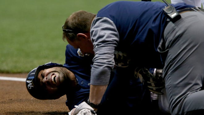 Brewers catcher Manny Pina is in considerable pain after getting hit by a pitch on the elbow from Diamondbacks starter Robbie Ray in the second inning.