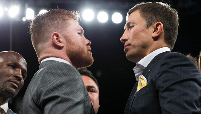 Canelo Alvarez, left, and Gennady Golovkin face off after their Sept. 16 fight was announced following Alvarez's victory against Julio Cesar Chavez Jr. in May.