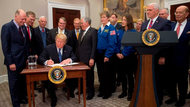 President Trump signs a Space Policy Directive.