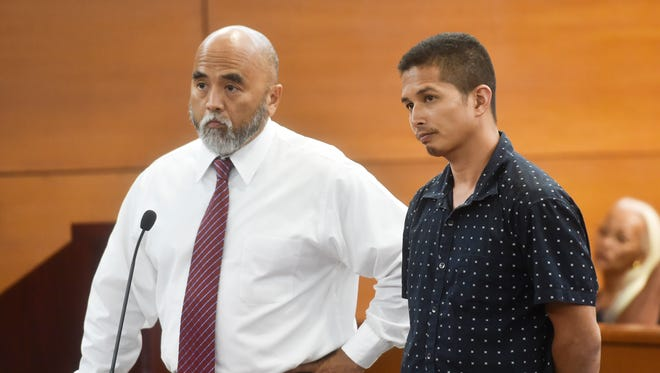 In this May 31, 2017, file photo Joshua John Untalan Mesa, right, stands next to his attorney Leonardo Rapadas during his arraignment hearing at the Superior Court of Guam Northern Court Satellite in Dededo. Mesa also sued the airport in the District Court of Guam after he was allegedly shot by an airport police officer in 2016.