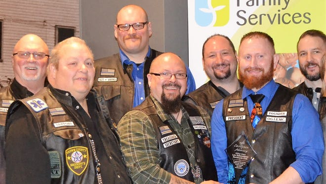 Members of The Other Guys Law Enforcement Motorcycle Club are seen with their Excellence in Advocacy Award presented on April 2 by Family Services of Northeast Wisconsin. Left to right are: Glenn Sowle of the Oconto Police Department, Dale Liebergen of the Oconto Falls Police Department (retired), Ron Ripley of the Oconto County Sheriff's Office, Mike Short of the Florence County Sheriff's Office, Adam Heynen of the Shawano County Sheriff's Office, Justen Ragen of the Oconto County Sheriff's Office, and Keith Fischer of the Oconto Falls Police Department. Missing was Karl Gorlinger of the Marinette County Sheriff's Office.