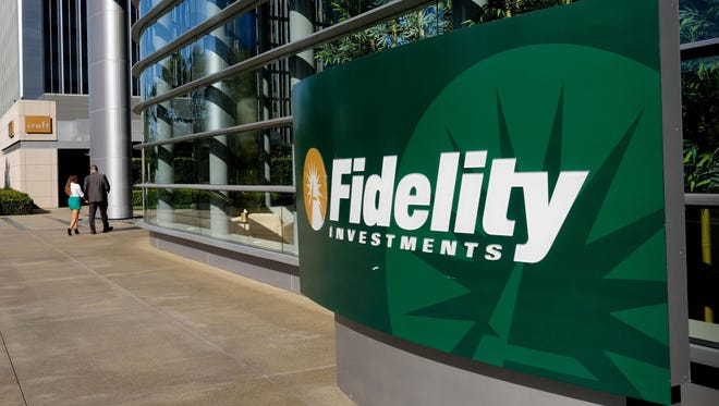 This Thursday, June 16, 2016, file photo shows a sign outside of a Fidelity Investments office in the Century City section of Los Angeles. On Tuesday, Feb. 28, 2017, Fidelity became the latest company to cut its fees in an ongoing industry battle that's helped mom-and-pop investors keep more of their own dollars. A rival matched the price cut in only a matter of hours.