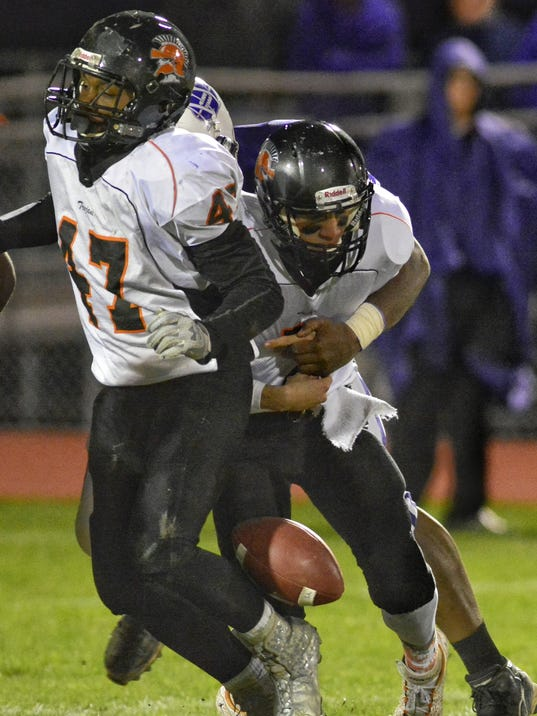 York Suburban quarterback is sacked and fumbles the football during Friday's District 3-AAA first round playoff game against Northern York. The Trojans lost to the Polar Bears, 30-16, ending their season.