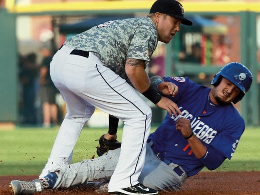 El Paso second baseman Taylor Lindsey tags out Las Vegas baserunner Carrell Ceciliani on an attempted steal Monday.