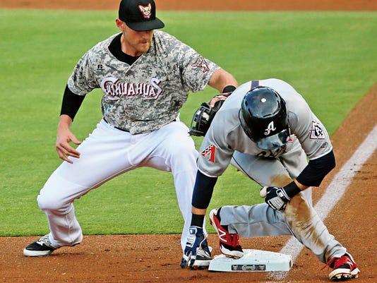 El Paso third baseman Will Middlebrooks puts a tag on Reno baserunner Michael Freeman on Monday. Freeman was safe at third.