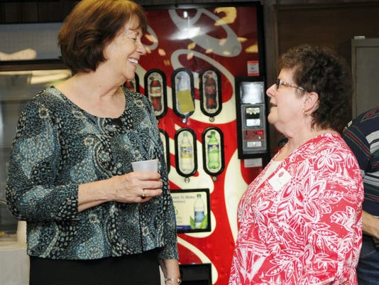 Former State Rep. RoseMarie Swanger speaks with Cheryl Kline during a reception honoring Swanger at Hebron Bingo Hall on Sunday.