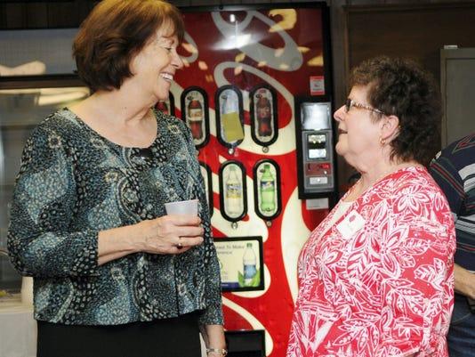 Former State Rep. RoseMarie Swanger speaks with Cheryl Kline during a reception honoring Swanger at Hebron Bingo Hall on Sunday.