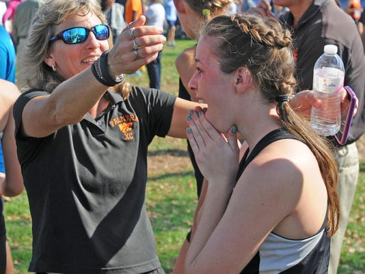 Barb Mellinger celebrates with Mariah Ricci after finding out Palmyra won the District Three girls AA cross country championship in 2012. Mellinger resigned Monday after 12 years as the Cougars' cross country coach to accept a teaching position at Milton Hershey.