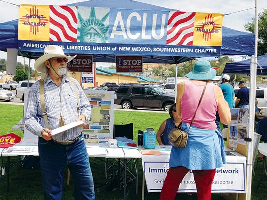 William Hudson, president of the Southwestern Chapter of the ACLU-NM, at left, was at the chapter booth in Gough Park on July 4 in Silver City. The ACLU chapter is looking for members to serve on its board of directors. Randal Seyler - Sun-News