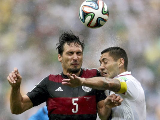 Germany's Mats Hummels heads the ball away from United States' Clint Dempsey during the teams' World Cup soccer match in Recife, Brazil on Thursday.
