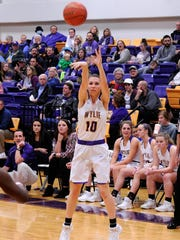 Wylie guard Abbey Henson (10) takes a 3-point shot