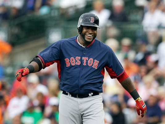 Boston Red Sox designated hitter David Ortiz walks back to the dugout after grounding out to end the first inning of a spring exhibition baseball game against the Baltimore Orioles in Sarasota, Fla., Monday, March 24, 2014. (AP Photo/Carlos Osorio)
