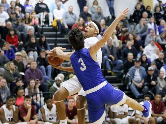 Nahjor Mack of Elmira goes up for a shot as Mike Limoncelli of Horseheads defends Dec. 18 at Elmira High School.