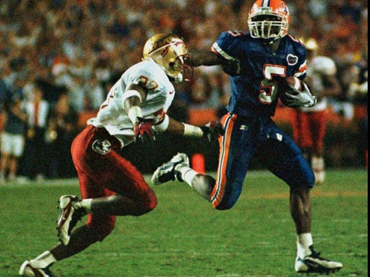 Florida wide receiver Jacquez Green (5) gets away from Florida State's Tay Cody (27) to help set-up the Gator's game winning score late in the fourth quarter of a 32-29 win on Nov. 22, 1997 in Gainesville.