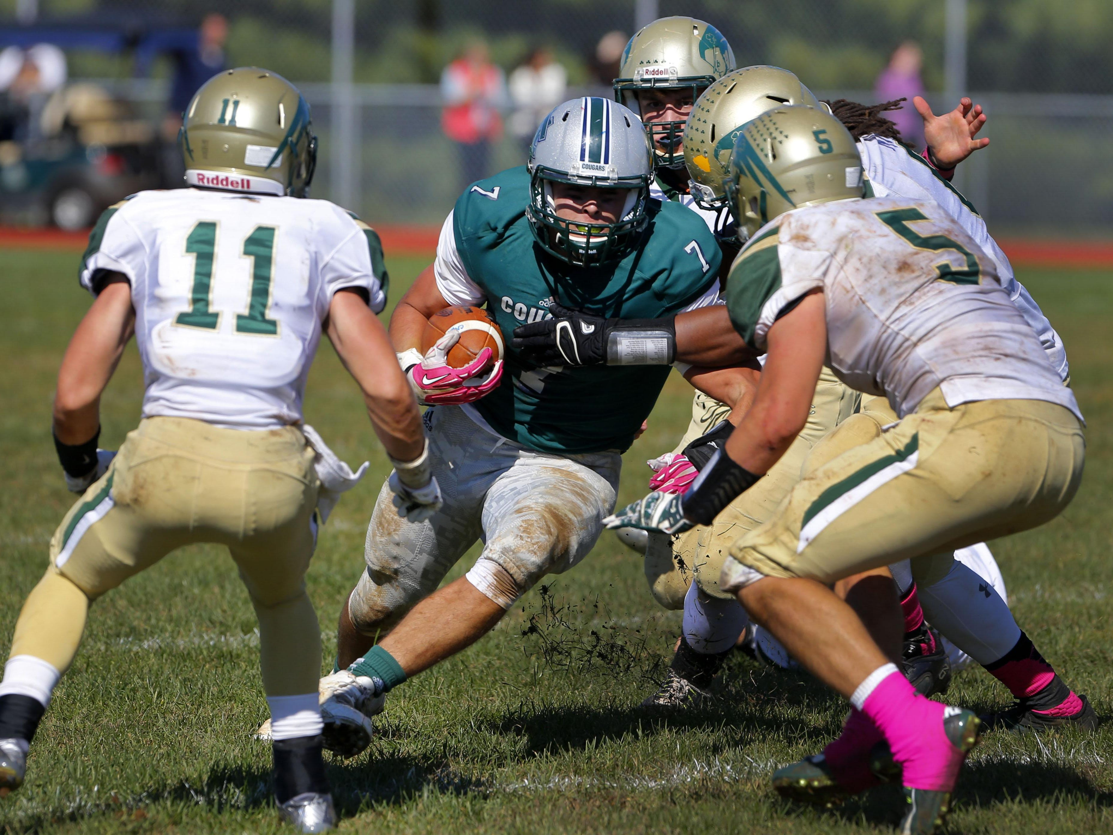 Max Mullaney (7) of Colts runs into Red Bank Catholic defenders Michael Bazofiore (11) and Michael Wilen (5) during game at Colts Neck High School, Colts Neck,NJ. Saturday, October 10, 2015.