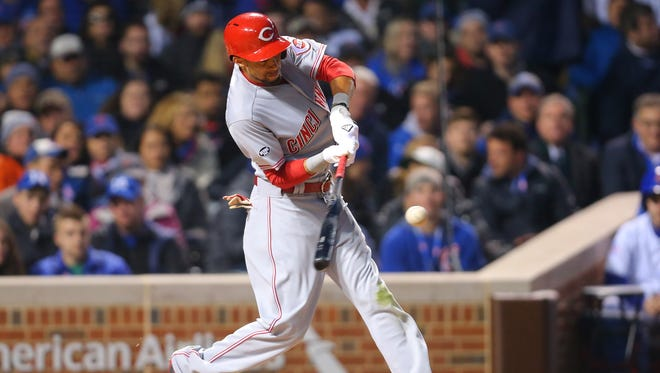 Cincinnati Reds center fielder Billy Hamilton (6) hits a home run during the third inning against the Chicago Cubs at Wrigley Field on April 11, 2016.