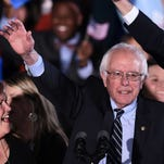 US Democratic presidential candidate Bernie Sanders waves during the primary night rally in Concord, New Hampshire, on February 9, 2016.