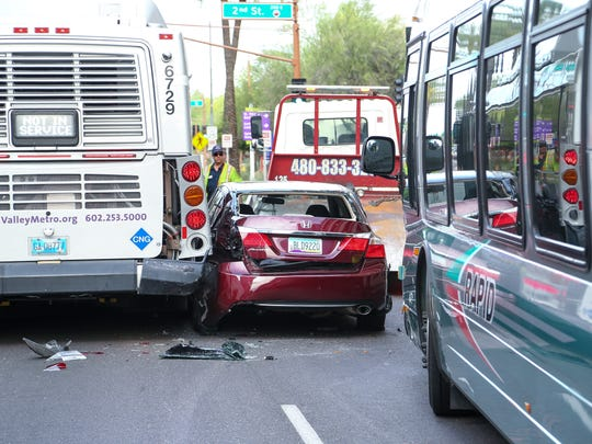 Van Buren Street was briefly closed Monday after a car was lodged between two city buses, police said.