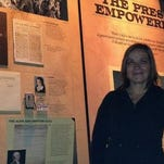 Former Hattiesburg American reporter Antoinette Konz poses at the Newseum in Washington, D.C., with a display that details her run-in with a U.S. marshal during a 2004 speech in Hattiesburg by U.S. Supreme Court Justice Antonin Scalia.
