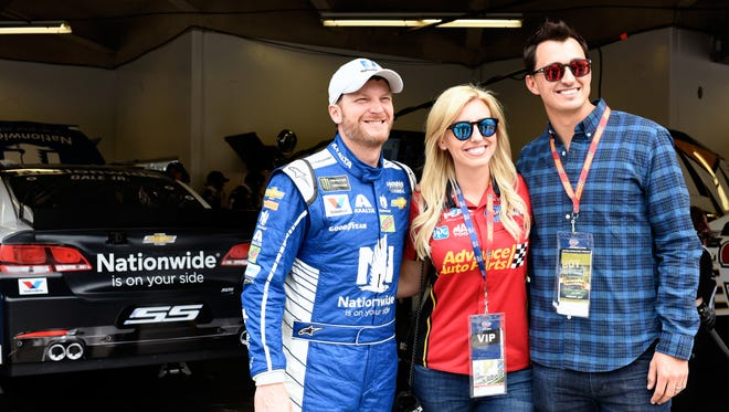 Courtney Force, center, Dale Earnhardt Jr., left, and her husband, Graham Rahal, right, found some time to chat Saturday at Daytona International Speedway.