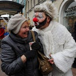 Artists perform a clown act on April Fools' Day in St. Petersburg, Russia.